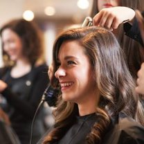 Photo-Female_Client_Smiles_During_Haircut-0101-50_292x292